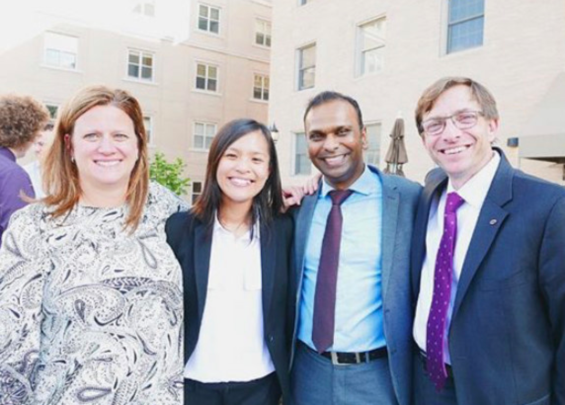 Pitt entrepreneurs in residence (one on the far left and the other on the far right) smiling and taking a picture with two students (in the middle).