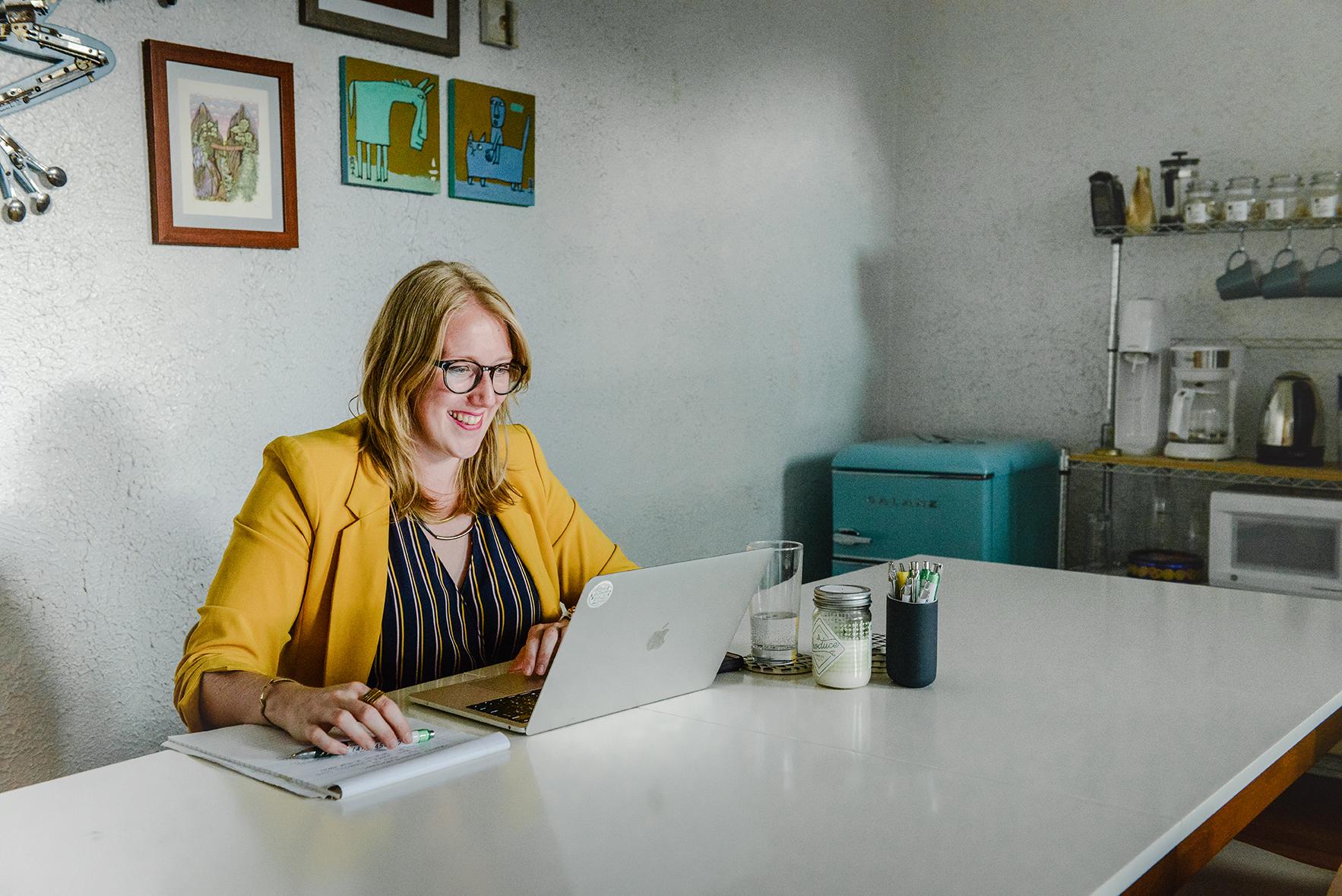 Marlene van Nelson doing work at a computer at her desk